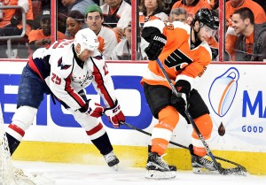 Apr 20, 2016; Philadelphia, PA, USA; Washington Capitals left wing Jason Chimera (25) reaches for the puck as Philadelphia Flyers defenseman Shayne Gostisbehere (53) defends during the third period in game four of the first round of the 2016 Stanley Cup Playoffs at Wells Fargo Center. The Flyers won 2-1. Mandatory Credit: Eric Hartline-USA TODAY Sports