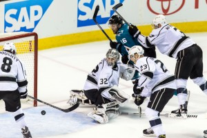 Apr 20, 2016; San Jose, CA, USA; Los Angeles Kings goalie Jonathan Quick (32) deflects a shot by San Jose Sharks center Nick Spaling (16) in the third period of game four of the first round of the 2016 Stanley Cup Playoffs at SAP Center at San Jose. The Sharks won 3-2. Mandatory Credit: John Hefti-USA TODAY Sports
