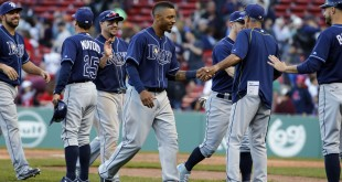 Apr 21, 2016; Boston, MA, USA; The Tampa Bay Rays celebrate after defeating the Boston Red Sox in the ninth inning at Fenway Park. Tampa Bay defeated the Red Sox 12-8. Mandatory Credit: David Butler II-USA TODAY Sports