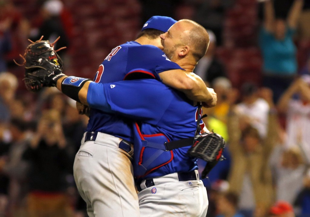 Apr 21, 2016; Cincinnati, OH, USA; Chicago Cubs starting pitcher Jake Arrieta (left) is congratulated by catcher David Ross (right) after Arrieta pitched a no-hitter against the Cincinnati Reds at Great American Ball Park. The Cubs won 16-0. Mandatory Credit: David Kohl-USA TODAY Sports