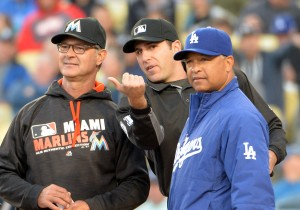 Apr 25, 2016; Los Angeles, CA, USA; Miami Marlins manager Don Mattingly (left), umpire Pat Hoberg (center) and Los Angeles Dodgers manager Dave Roberts (30) during a MLB game at Dodger Stadium. Mandatory Credit: Kirby Lee-USA TODAY Sports