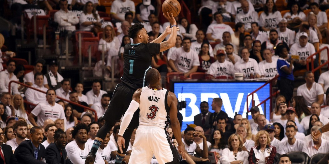 harlotte Hornets guard Courtney Lee (1) shoots as Miami Heat guard Dwyane Wade (3) looks on during the second half in game five of the first round of the NBA Playoffs at American Airlines Arena.