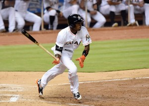 Apr 5, 2016; Miami, FL, USA; Miami Marlins second baseman Dee Gordon (9) connects for a triple during the sixth inning against the Detroit Tigers at Marlins Park. Mandatory Credit: Steve Mitchell-USA TODAY Sports