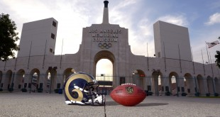 Mar 4, 2016; Los Angeles, CA, USA; General view of Los Angeles Rams helmet and NFL Wilson Duke football and the Olympic torch at the peristyle end of the Los Angeles Memorial Coliseum. The Coliseum will serve as the temporary home of the Rams after NFL owners voted 30-2 to allow Rams owner Stan Kroenke (not pictured) to relocate the franchise for the 2016 season. Mandatory Credit: Kirby Lee-USA TODAY Sports