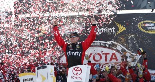 Apr 24, 2016; Richmond, VA, USA; Sprint Cup Series driver Carl Edwards (19) celebrates in Victory Lane after winning the Toyota Owners 400 at Richmond International Raceway. Mandatory Credit: Amber Searls-USA TODAY Sports