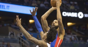 Orlando Magic guard Elfrid Payton (4) tries to block the shot from Detroit Pistons forward Marcus Morris (13) during the first quarter of a basketball game at Amway Center.