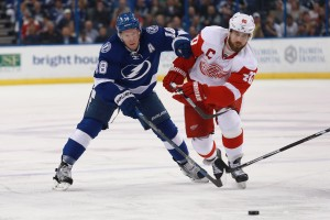 Mar 22, 2016; Tampa, FL, USA; Tampa Bay Lightning left wing Ondrej Palat (18) and Detroit Red Wings left wing Henrik Zetterberg (40) fight to control the puck during the first period at Amalie Arena. Mandatory Credit: Kim Klement-USA TODAY Sports