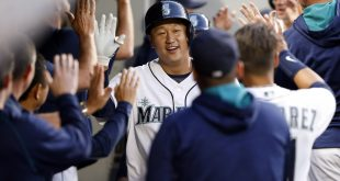 May 10, 2016; Seattle, WA, USA; Seattle Mariners first baseman Dae-Ho Lee (10) is greeted in the dugout after hitting a three-run homer against the Tampa Bay Rays during the fourth inning at Safeco Field. Mandatory Credit: Joe Nicholson-USA TODAY Sports
