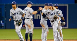 May 18, 2016; Toronto, Ontario, CAN; Tampa Bay Rays short stop Taylor Motter (38) exchanges a high-five with first baseman Logan Morrison (7) to celebrate defeating the Toronto Blue Jays at Rogers Centre. Rays won 6-3. Mandatory Credit: Kevin Sousa-USA TODAY Sports