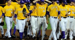 Jun 18, 2015; Omaha, NE, USA; The LSU Tigers team walks off the field after the loss to TCU Horned Frogs in the 2015 College World Series at TD Ameritrade Park. TCU defeated LSU 8-4. Mandatory Credit: Steven Branscombe-USA TODAY Sports