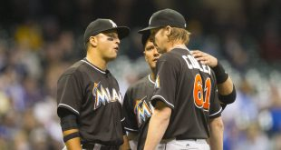 Apr 29, 2016; Milwaukee, WI, USA; Teammates talk with Miami Marlins pitcher Adam Conley (61) looks on from the mound during the eighth inning against the Milwaukee Brewers at Miller Park. Mandatory Credit: Jeff Hanisch-USA TODAY Sports