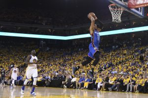 May 16, 2016; Oakland, CA, USA; Oklahoma City Thunder guard Russell Westbrook (0) dunks the basketball against the Golden State Warriors during the third quarter in game one of the Western conference finals of the NBA Playoffs at Oracle Arena. The Thunder defeated the Warriors 108-102. Mandatory Credit: Kyle Terada-USA TODAY Sports