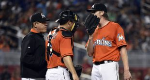May 22, 2016; Miami, FL, USA; Miami Marlins pitching coach Juan Nieves (L) talks with Marlins starting pitcher Adam Conley (R) and Marlins catcher Jeff Mathis (C) during the sixth inning against the Washington Nationals at Marlins Park. Mandatory Credit: Steve Mitchell-USA TODAY Sports