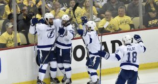 May 22, 2016; Pittsburgh, PA, USA; Tampa Bay Lightning defenseman Jason Garrison (5) and  Nikita Kucherov (86) and Tyler Johnson (9) and Ondrej Palat (18) celebrate after defeating the Pittsburgh Penguins in game five of the Eastern Conference Final of the 2016 Stanley Cup Playoffs at Consol Energy Center. Tampa Bay won 4-3 in OT.Mandatory Credit: Don Wright-USA TODAY Sports