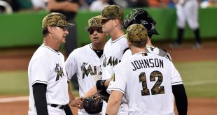 May 30, 2016; Miami, FL, USA; Miami Marlins manager Don Mattingly (left) talks with Marlins starting pitcher Justin Nicolino (center) on the pitchers mound during the sixth inning against the Pittsburgh Pirates at Marlins Park. Mandatory Credit: Steve Mitchell-USA TODAY Sports