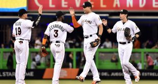 Jun 1, 2016; Miami, FL, USA; Miami Marlins second baseman Miguel Rojas (left to right) Marlins shortstop Adeiny Hechavarria, Marlins right fielder Giancarlo Stanton, Marlins left fielder Christian Yelich, celebrate their 3-2 win over the Pittsburgh Pirates at Marlins Park. Mandatory Credit: Steve Mitchell-USA TODAY Sports
