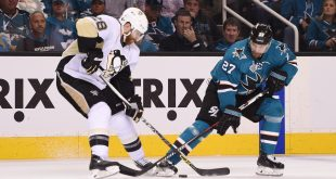 Jun 6, 2016; San Jose, CA, USA; San Jose Sharks right wing Joonas Donskoi (27) battles for the puck with Pittsburgh Penguins defenseman Ian Cole (28) in the first period in game four of the 2016 Stanley Cup Final at SAP Center at San Jose. Mandatory Credit: Kyle Terada-USA TODAY Sports