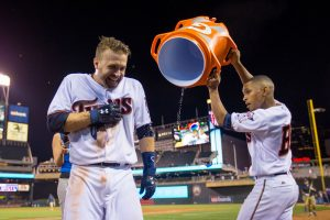 Jun 7, 2016; Minneapolis, MN, USA; Minnesota Twins bat boy Dominic Frost dumps gatorade on second baseman Brian Dozier (2) after his walk off home run in the eleventh inning against the Miami Marlins at Target Field. The Minnesota Twins beat the Miami Marlins 6-4 in 11 innings. Mandatory Credit: Brad Rempel-USA TODAY Sports
