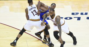 Jun 8, 2016; Cleveland, OH, USA; Cleveland Cavaliers forward LeBron James (23) dribbles the ball around Golden State Warriors forward Harrison Barnes (40) and Cavaliers center Tristan Thompson (13) during the third quarter in game three of the NBA Finals at Quicken Loans Arena. Mandatory Credit: Ken Blaze-USA TODAY Sports