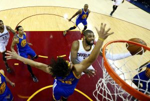 Jun 8, 2016; Cleveland, OH, USA; Cleveland Cavaliers guard Kyrie Irving (2) shoots the ball against Golden State Warriors forward Anderson Varejao (18) in game three of the NBA Finals at Quicken Loans Arena. Mandatory Credit: Ronald Martinez/Pool Photo via USA TODAY Sports