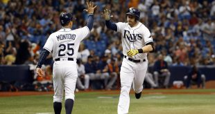 Jun 11, 2016; St. Petersburg, FL, USA; Tampa Bay Rays third baseman Evan Longoria (3) is congratulated by third base coach Charlie Montoyo (25) after hitting a home run against the Houston Astros during the sixth inning at Tropicana Field. Mandatory Credit: Kim Klement-USA TODAY Sports