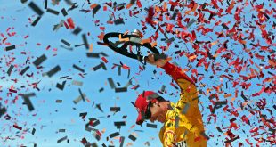 Jun 12, 2016; Brooklyn, MI, USA; Sprint Cup Series driver Joey Logano celebrates winning the FireKeepers Casino 400 at Michigan International Speedway. Mandatory Credit: Aaron Doster-USA TODAY Sports