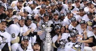 Jun 12, 2016; San Jose, CA, USA; Pittsburgh Penguins players pose for a team photo with the Stanley Cup after defeating the San Jose Sharks in game six of the 2016 Stanley Cup Final at SAP Center at San Jose. Mandatory Credit: Gary A. Vasquez-USA TODAY Sports