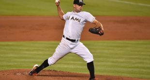 Jul 25, 2016; Miami, FL, USA; Miami Marlins starting pitcher Jarred Cosart (59) delivers a pitch in the game against the Philadelphia Phillies at Marlins Park. Mandatory Credit: Jasen Vinlove-USA TODAY Sports