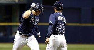 Jul 5, 2016; St. Petersburg, FL, USA; Tampa Bay Rays first baseman Logan Morrison (7) is congratulated by third base coach Charlie Montoyo (25) as he runs around the bases after he hit a home run during the third inning against the Los Angeles Angels at Tropicana Field. Mandatory Credit: Kim Klement-USA TODAY Sports
