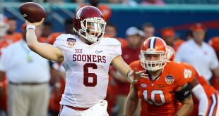 Dec 31, 2015; Miami Gardens, FL, USA; Oklahoma Sooners quarterback Baker Mayfield (6) throws against Clemson Tigers linebacker Ben Boulware (10) during the second quarter of the 2015 CFP semifinal at the Orange Bowl at Sun Life Stadium.  Mandatory Credit: Steve Mitchell-USA TODAY Sports