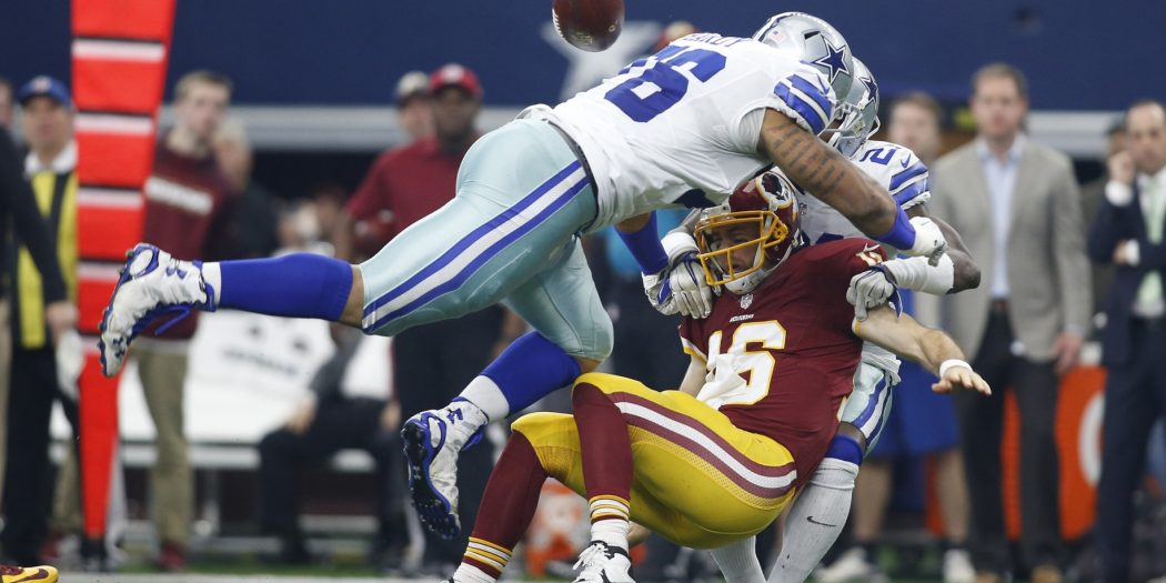 Jan 3, 2016; Arlington, TX, USA; Washington Redskins quarterback Kirk Cousins (8) fumbles the ball after being sacked by Dallas Cowboys defensive end Greg Hardy (76) and cornerback Terrance Mitchell (21) at AT&T Stadium. Mandatory Credit: Tim Heitman-USA TODAY Sports