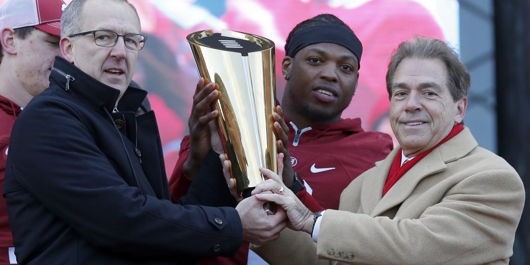 Jan 23, 2016; Tuscaloosa, AL, USA; Southeastern conference commissioner Greg Sankey holds the College Football Playoff trophy with Alabama running back Derrick Henry (2) and head coach Nick Saban during a presentation to celebrate the victory in the CFP National Championship game at Bryant-Denny Stadium. Mandatory Credit: Butch Dill-USA TODAY Sports