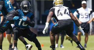 Jun 14, 2016; Jacksonville, FL, USA; Jacksonville Jaguars running back Denard Robinson (16) runs as Jacksonville Jaguars linebacker Myles Jack (44) defends during minicamp workouts at Florida Blue Health and Wellness Practice Fields. Mandatory Credit: Logan Bowles-USA TODAY Sports