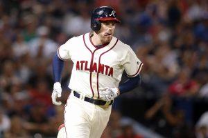 Atlanta Braves first baseman Freddie Freeman (5) singles against the New York Mets in the ninth inning at Turner Field. Mandatory Credit: Brett Davis-USA TODAY Sports