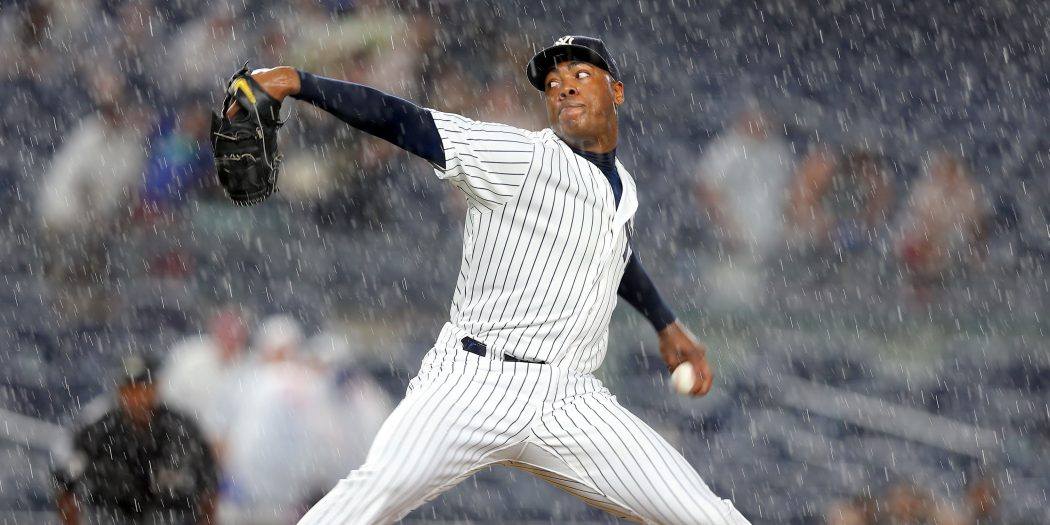 Jun 27, 2016; Bronx, NY, USA; New York Yankees relief pitcher Aroldis Chapman (54) pitches in the rain against the Texas Rangers during the ninth inning at Yankee Stadium. Mandatory Credit: Brad Penner-USA TODAY Sports