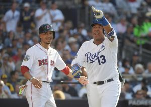 Jul 12, 2016; San Diego, CA, USA; American League catcher Salvador Perez (13) of the Kansas City Royals celebrates with American League outfielder Mookie Betts (50) of the Boston Red Sox after hitting a two-run home run in the second inning in the 2016 MLB All Star Game at Petco Park. Mandatory Credit: Kirby Lee-USA TODAY Sports