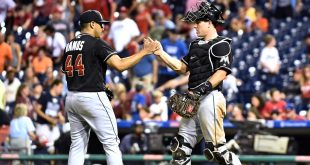 Jul 19, 2016; Philadelphia, PA, USA; Miami Marlins relief pitcher A.J. Ramos (44) and catcher J.T. Realmuto (11) celebrate a win against the Philadelphia Phillies at Citizens Bank Park. The Marlins defeated the Phillies 2-1 in 10 innings. Mandatory Credit: Eric Hartline-USA TODAY Sports