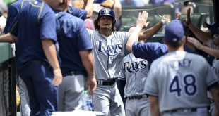 Jul 20, 2016; Denver, CO, USA; Tampa Bay Rays starting pitcher Chris Archer (22) celebrates scoring a run in the third inning against the Colorado Rockies at Coors Field. Mandatory Credit: Ron Chenoy-USA TODAY Sports