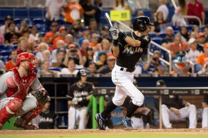 Jul 26, 2016; Miami, FL, USA; Miami Marlins right fielder Ichiro Suzuki (51) hits a single during the eighth inning against the Philadelphia Phillies at Marlins Park. Mandatory Credit: Steve Mitchell-USA TODAY Sports