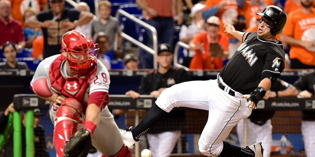 Jul 26, 2016; Miami, FL, USA; Miami Marlins third baseman Martin Prado (14) scores a run past Philadelphia Phillies catcher Cameron Rupp (29) at home plate during the sixth inning at Marlins Park. Mandatory Credit: Steve Mitchell-USA TODAY Sports