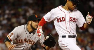 Jul 19, 2016; Boston, MA, USA; San Francisco Giants relief pitcher George Kontos (70) hangs onto the ball after tagging out Boston Red Sox right fielder Mookie Betts (50) during the eighth inning at Fenway Park. Mandatory Credit: Winslow Townson-USA TODAY Sports