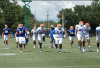 Gator football players warming up before Monday's practice