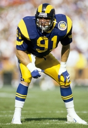 Nov 13, 1988; Anaheim, CA, USA; FILE PHOTO; Los Angeles Rams linebacker Kevin Greene (91) in action against the New Orleans Saints at Anaheim Stadium. Mandatory Credit: USA TODAY Sports