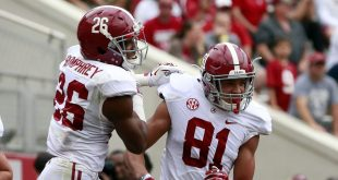 Apr 16, 2016; Tuscaloosa, AL, USA; Alabama Crimson Tide defensive back Marlon Humphrey (26) celebrates with Alabama Crimson Tide wide receiver Derek Kief (81) after Kief scored a touchdown at Bryant-Denny Stadium. Mandatory Credit: Marvin Gentry-USA TODAY Sports