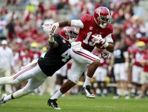 Apr 16, 2016; Tuscaloosa, AL, USA; Alabama Crimson Tide wide receiver ArDarius Stewart (13) attempts to get away from Alabama Crimson Tide defensive back Eddie Jackson (4) at Bryant-Denny Stadium. Mandatory Credit: Marvin Gentry-USA TODAY Sports