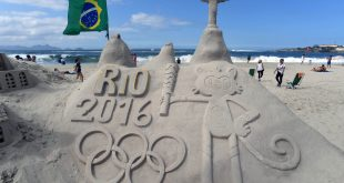 Jul 31, 2016; Rio de Janeiro, BRAZIL; A sand sculpture and flag at Copacabana Beach prior to the start of the Rio 2016 Olympic Games. Mandatory Credit: Michael Madrid-USA TODAY Sports