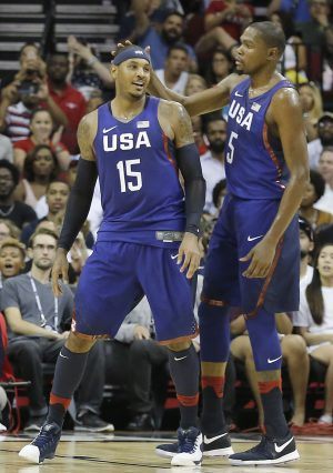 Aug 1, 2016; Houston, TX, USA; United States guard Kevin Durant (5) congratulates forward Carmelo Anthony (15) after making a basket against Nigeria in the second quarter during an exhibition basketball game between United States and Nigeria at Toyota Center. Mandatory Credit: Thomas B. Shea-USA TODAY Sports