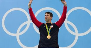 Aug 11, 2016; Rio de Janeiro, Brazil; Michael Phelps (USA) with his gold medal after the men's 200m individual medley final in the Rio 2016 Summer Olympic Games at Olympic Aquatics Stadium. Mandatory Credit: Rob Schumacher-USA TODAY Sports