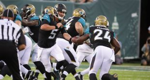 Aug 11, 2016; East Rutherford, NJ, USA; Jacksonville Jaguars quarterback Blake Bortles (5) hands off to running back T.J. Yeldon (24) during the preseason game against the New York Jets at MetLife Stadium. The Jets won, 17-13.  Mandatory Credit: Vincent Carchietta-USA TODAY Sports