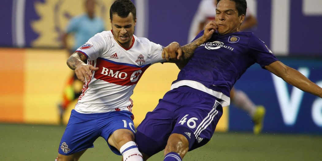 Aug 24, 2016; Orlando, FL, USA; Toronto FC forward Sebastian Giovinco (10) and Orlando City SC midfielder Tony Rocha (46) battle for the ball during the first half at Camping World Stadium. Mandatory Credit: Kim Klement-USA TODAY Sports